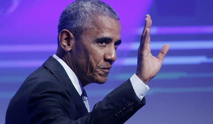 Former U.S. President Barack Obama waves before he is awarded the German Media Prize 2016 in Baden-Baden, Germany, Thursday, May 25, 2017. (AP Photo/Michael Probst)