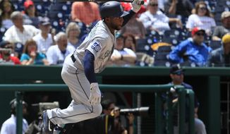 Seattle Mariners Guillermo Heredia (5) runs to first base on fielder's choice during the seventh inning of a baseball game against the Washington Nationals in Washington, Thursday, May 25, 2017. The Mariners won 4-2. (AP Photo/Manuel Balce Ceneta)