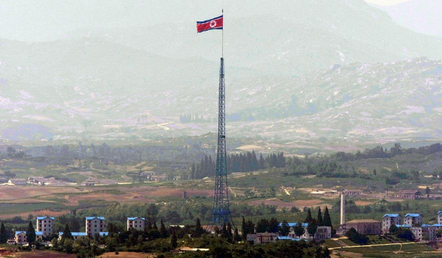 In this Wednesday, May 27, 2009, photo, a giant North Korean flag flutters on the top of a 160-meter (533-foot) tower in North Korea as it is pictured from the demilitarized zone (DMZ) near the border village of Panmunjom that separates the two Koreas since the Korean War, in Paju, South Korea. North Korea on Thursday, May, 25, 2017, accused South Korea of recently firing 450 rounds from machine guns at a flock of birds at the rivals border, dismissing as a fabrication Seoul's claim that it fired warning shots at an object flying from the North. (AP Photo/ Lee Jin-man, File)
