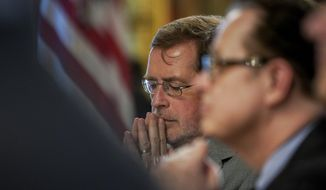 Grover Norquist of Americans for Tax Reform, center, attends a meeting held by Budget Director Mick Mulvaney in the Eisenhower Executive Office Building on the White House complex in Washington, Thursday, May 25, 2017. (AP Photo/Andrew Harnik)