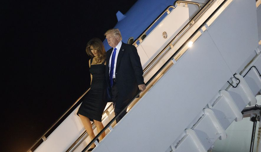 President Donald Trump and first lady Melania Trump walk off Air Force One after arriving at Naval Air Station Sigonella, Thursday, May 25, 2017, in Sigonella, Italy. (AP Photo/Evan Vucci)