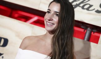 FILE - In this Feb. 3, 2017, file photo, Aly Raisman attends ESPN: The Party 2017 in Houston, Texas. Raisman used Twitter on May 24, 2017, to call out an airport security worker who she says questioned whether she had enough muscles to be a gymnast. (Photo by John Salangsang/Invision/AP, File)