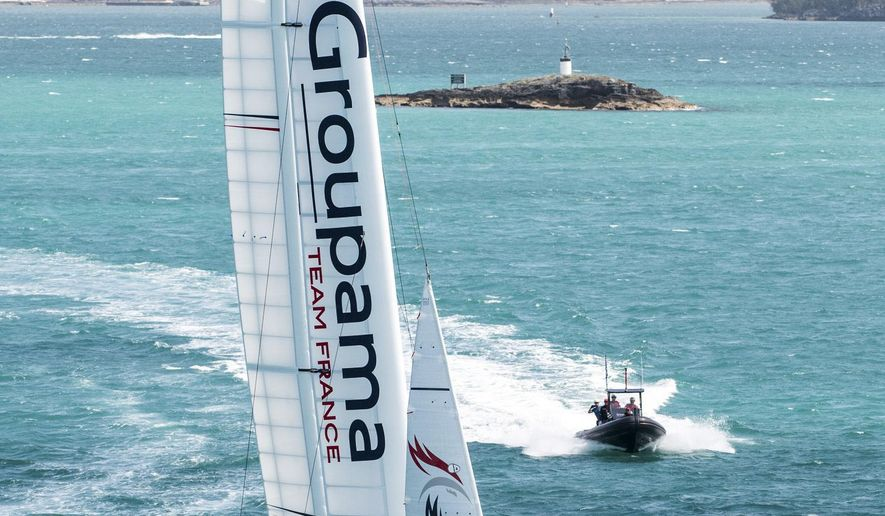 In this photo provided by the America's Cup Event Authority, Groupama Team France sails during a practice session on the Great Sound in Bermuda on Wednesday, May 24, 2017. America's Cup competition begins in Bermuda May 26. (Ricardo Pinto/ACEA via AP)