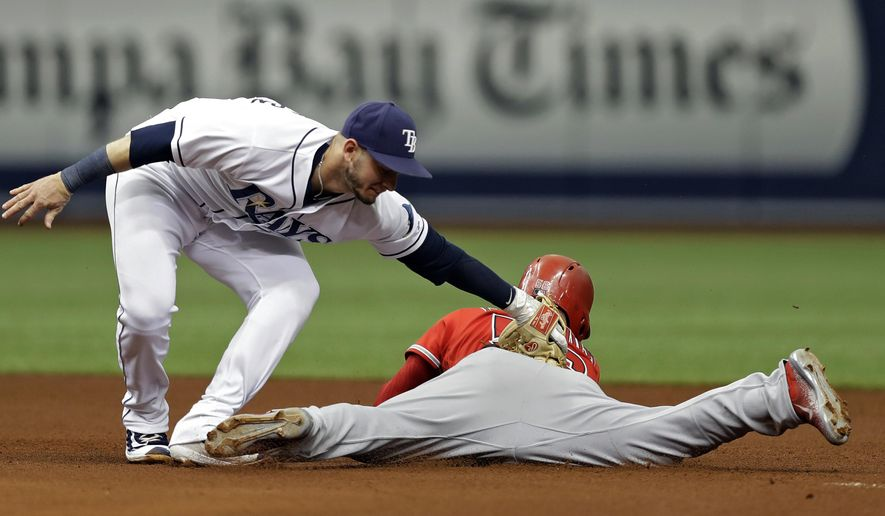 Los Angeles Angels' Kole Calhoun slides into second base with a double ahead of the tag by Tampa Bay Rays shortstop Daniel Robertson during the fourth inning of a baseball game Thursday, May 25, 2017, in St. Petersburg, Fla. (AP Photo/Chris O'Meara)