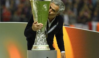 United manager Jose Mourinho kisses the trophy after winning the soccer Europa League final between Ajax Amsterdam and Manchester United at the Friends Arena in Stockholm, Sweden, Wednesday, May 24, 2017. United won 2-0. (AP Photo/Martin Meissner)