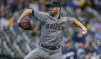 Arizona Diamondbacks' Robbie Ray pitches to a Milwaukee Brewers' batter during the first inning of a baseball game Thursday, May 25, 2017, in Milwaukee. (AP Photo/Tom Lynn)My