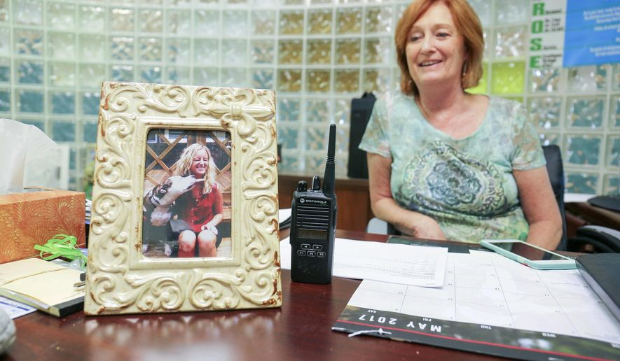 ADVANCE FOR SUNDAY, MAY 28, 2017 - In this Friday, May 19, 2017 photo, vice principal of J.H. Rose High School Lettie Michelleto talks about her daughter Megan, who passed in 2014 from a heroin overdose as she sits at her desk in Greenville, N.C. ( Juliette Cooke/The Daily Reflector via AP)