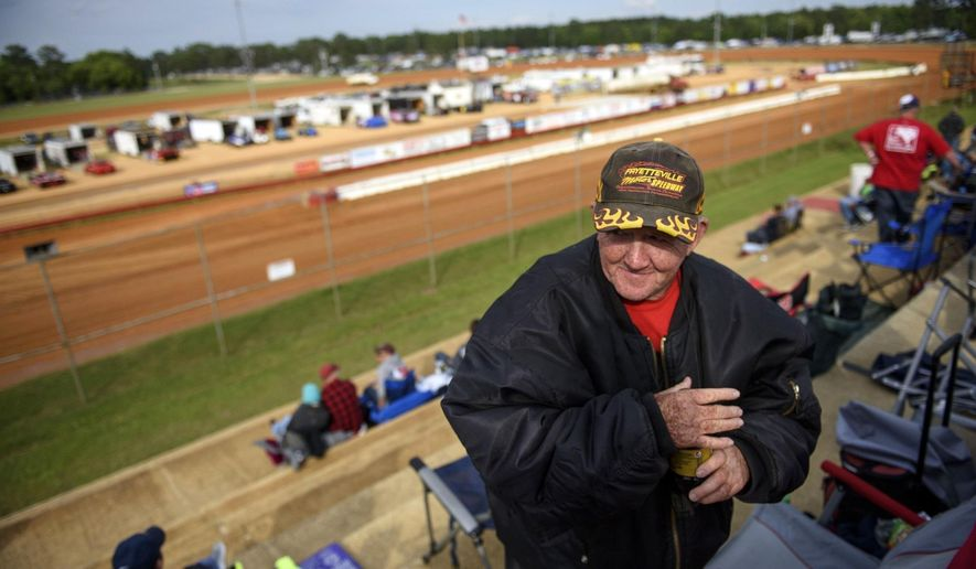 Danny McDaniel sips a Pepsi before settling into his seat at the 4th turn of the Fayetteville Motor Speedway May 6, 2017. (Melissa Sue Gerrits /The Fayetteville Observer via AP)