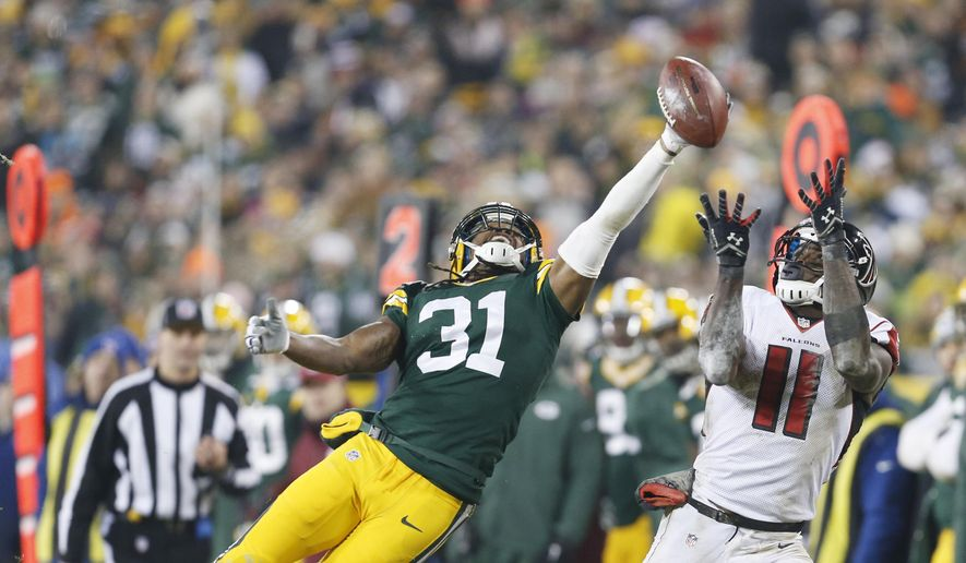 FILE - In this Dec. 8, 2014, file photo, Green Bay Packers' Davon House breaks up a pass intended for Atlanta Falcons' Julio Jones during the second half of an NFL football game in Green Bay, Wis. House left Green Bay for two years to play in Jacksonville, but in his heart he never really left. He even kept his Packers gear and taped their games. Now the cornerback is back in Green Bay.  (AP Photo/Mike Roemer, File) **FILE**