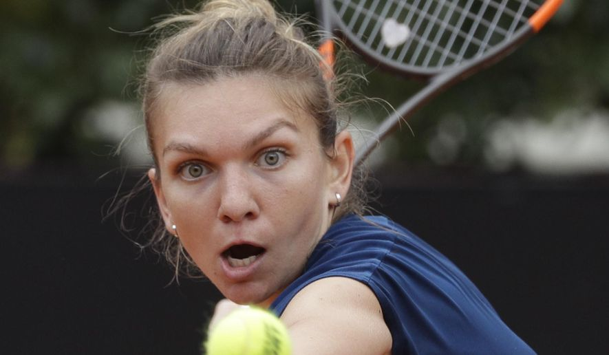 FILE - In this May 20, 2017, file photo, Simona Halep eyes the ball during her semifinal match against Kiki Bertens at the Italian Open tennis tournament, in Rome. Halep will be competing in the French Open. (AP Photo/Gregorio Borgia, File)