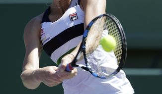FILE - In this March 28, 2017, file photo, Karolina Pliskova hits a return to Mirjana Lucic-Baroni during the Miami Open tennis tournament, in Key Biscayne, Fla. Pliskova will be competing in the French Open. (AP Photo/Lynne Sladky, File)