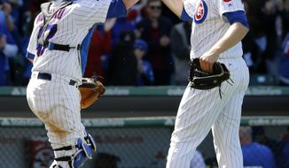 Chicago Cubs catcher Miguel Montero, left, and relief pitcher Mike Montgomery celebrate the Cubs' 5-1 win over the San Francisco Giants after a baseball game Thursday, May 25, 2017, in Chicago. (AP Photo/Charles Rex Arbogast)