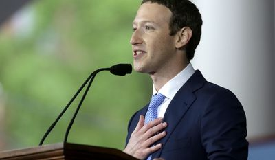 Facebook CEO and Harvard dropout Mark Zuckerberg delivers the commencement address at Harvard University commencement exercises, Thursday, May 25, 2017, in Cambridge, Mass., (AP Photo/Steven Senne)
