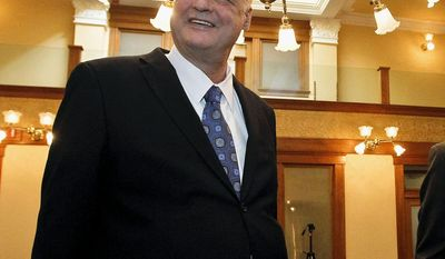FILE- In this Dec. 3, 2012 file photo, Arizona Attorney General Tom Horne smiles during the official election canvass approval signing at the Historic Senate Chambers at the Capitol in Phoenix. The Arizona Supreme Court is expected to rule Thursday on former Arizona Attorney General Horne's appeal of a ruling that found he violated campaign finance laws during his 2010 campaign and put him on the hook to repay $400,000 to donors and a possible $1.2 million fine. (AP Photo/Ross D. Franklin, File)
