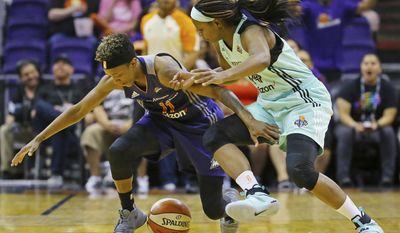 Phoenix Mercury guard Danielle Robinson (11) and New York Liberty guard Sugar Rodgers (14) fight for a loose ball during the first half of their WNBA basketball game, Tuesday, May 23, 2017 in Phoenix, Ariz. (David Kadlubowski/The Arizona Republic via AP)