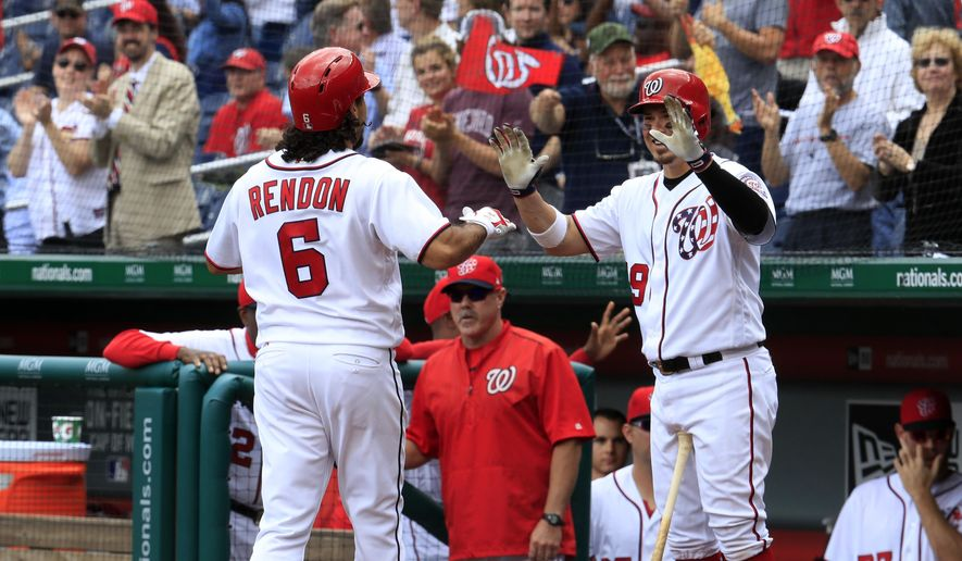 Washington Nationals' Anthony Rendon (6) is congratulated by Jose Lobaton (59) after hitting a home run during the fifth inning of a baseball game against the Seattle Mariners in Washington, Thursday, May 25, 2017. (AP Photo/Manuel Balce Ceneta)