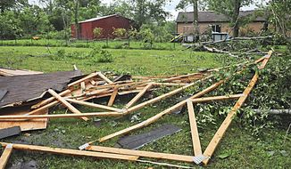 This May 25, 2017, photo shows downed trees and debris along Bellefontaine Road in New Carlisle, Ohio. Following severe overnight storms in western Ohio, suspected tornado damage was reported Thursday, May 25, 2017, in Clark, Greene and Miami counties north and east of Dayton, Ohio. (Marshall Gorby/Dayton Daily News via AP)