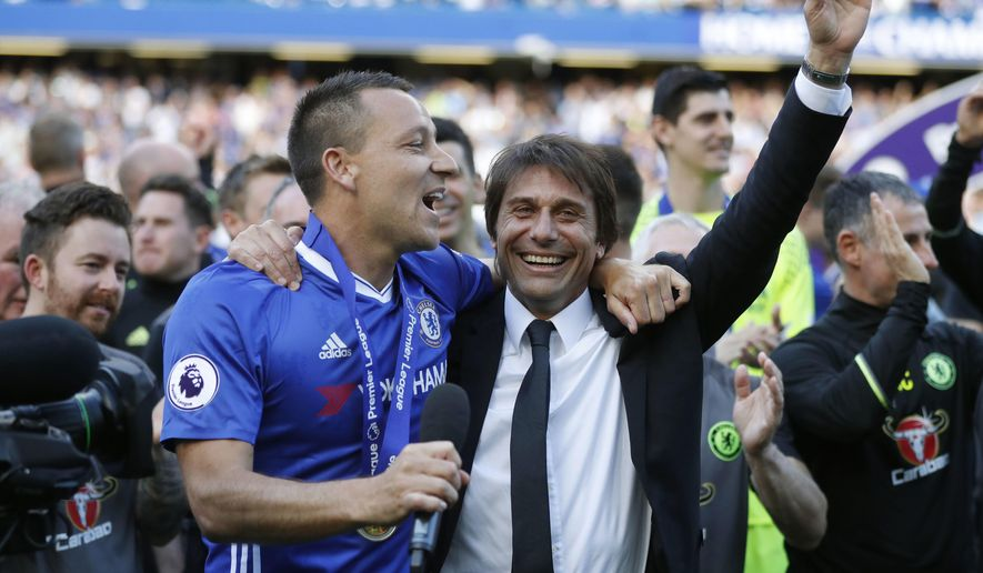 FILE - In this Sunday, May 21, 2017 file photo, Chelsea captain John Terry celebrates with manager Antonio Conte after they won the league, following the English Premier League soccer match between Chelsea and Sunderland at Stamford Bridge stadium in London. Antonio Conte acknowledges it's been a great first season with Chelsea, the new English Premier League champion. It could have a sweeter ending on Saturday, May 27 if they can take the FA Cup, too. (AP Photo/Frank Augstein, file)