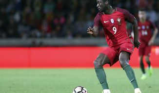 FILE - In this Tuesday, March 28 2017 file photo, Portugal's Eder controls the ball during the international friendly soccer match between Portugal and Sweden at the dos Barreiros stadium in Funchal, Madeira island, Portugal. Portugal is going to the Confederations Cup without Eder, its goal-scoring hero in the final of the European Championship, and rising star Renato Sanches.(AP Photo/Armando Franca, file)