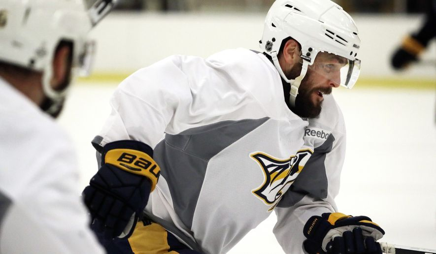 "Nashville Predators center Mike Fisher skates during practice at the team's NHL hockey facility Thursday, May 25, 2017, in Nashville, Tenn. Fisher did not play in the final two games of the Western Conference finals against the Anaheim Ducks after suffering a head injury in Game 4. Predators general manager David Poile said Wednesday there's ""a real good chance"" Fisher could return in Game 1 of the Stanley Cup Finals on May 29. (AP Photo/Mark Humphrey)"