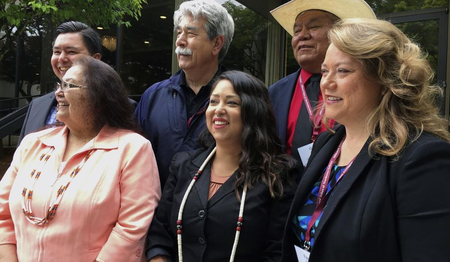 Tribal leaders from the Pacific Northwest pose for a picture during a meeting of the Members of the Affiliated Tribes of Northwest Indians in Portland, Ore., Thursday, May 25, 2017. The group held a news conference during their annual convention to criticize cuts to Native American programs in President Donald Trump's proposed budget that they say will devastate tribes across the U.S. Front row, from left, are Cheryl Kennedy, vice chairwoman of the Confederated Tribes of the Grand Ronde; Carina Miller, councilwoman with the Confederated Tribes of Warm Springs; and Fawn Sharp, president of the Affiliated Tribes of Northwest Indians. Back row, from left, are Timothy Ballew, member of the Lummi Nation; Mel Sheldon, councilman with the Tulalip Tribes and Gary Burke, chairman of the board of trustees for the Confederated Tribes of the Umatilla Indian Reservation. (AP Photo/Gillian Flaccus)