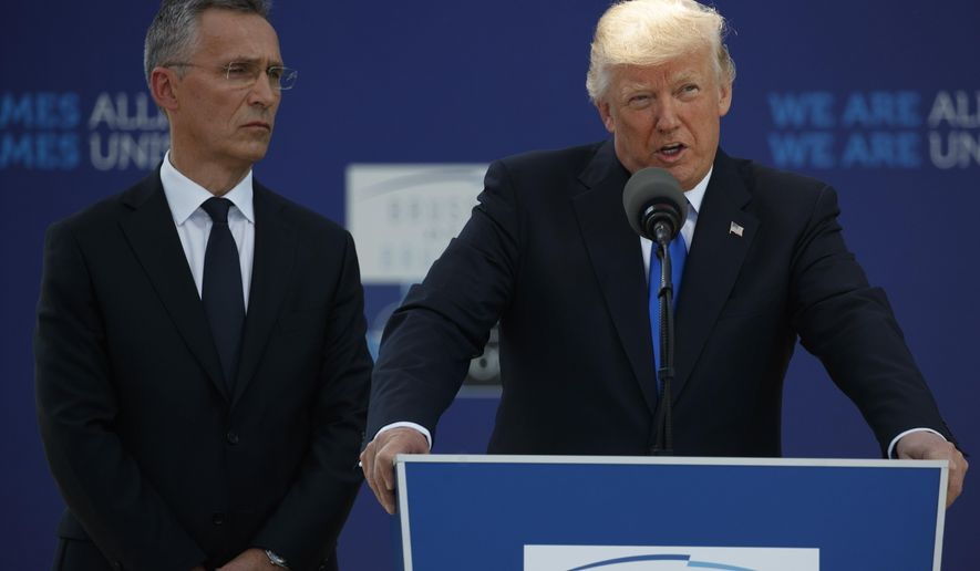 NATO Secretary General Jens Stoltenberg listens as President Donald Trump speaks during a ceremony to unveil artifacts from the World Trade Center and Berlin Wall for the new NATO headquarters, Thursday, May 25, 2017, in Brussels. (AP Photo/Evan Vucci)