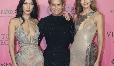 Models Bella Hadid, left, and Gigi Hadid, right, pose with their mother Yolanda