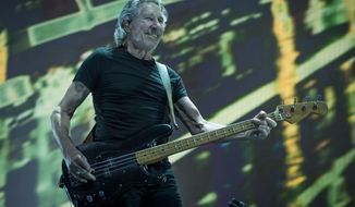 Roger Waters performs during the Roger Waters  Us + Them concert at the Sprint Center on Friday, May 26, 2017, in Kansas City, Mo. (Shane Keyser/The Kansas City Star via AP)