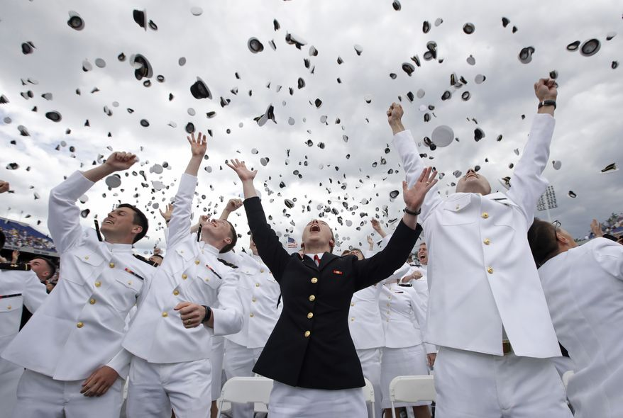 U.S. Naval Academy graduates celebrate at the end of the academy's graduation and commissioning ceremony in Annapolis, Md., Friday, May 26, 2017. (AP Photo/Patrick Semansky)