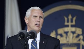 Vice President Mike Pence addresses the graduating class of U.S. Naval Academy midshipmen during the Academy's graduation and commissioning ceremony in Annapolis, Md., Friday, May 26, 2017. (AP Photo/Patrick Semansky) ** FILE **