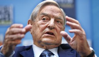 FILE - In this Sept. 24, 2011, file photo, George Soros speaks during a forum at the IMF/World Bank annual meetings in Washington. The AP reported on May 26, 2017, that a story shared online that claims Soros was federally indicted for voter machine fraud is a hoax. (AP Photo/Manuel Balce Ceneta, File)