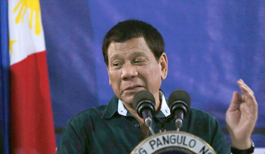 Philippine President Rodrigo Duterte addresses troops during his visit to the 2nd Mechanized Brigade Friday, May 26, 2017, on the outskirts of Iligan city in southern Philippines. Duterte told the troops fighting Muslim militants for the control of southern Marawi city to use martial law powers to defeat the Islamic State group-linked extremists. (AP Photo/Bullit Marquez)