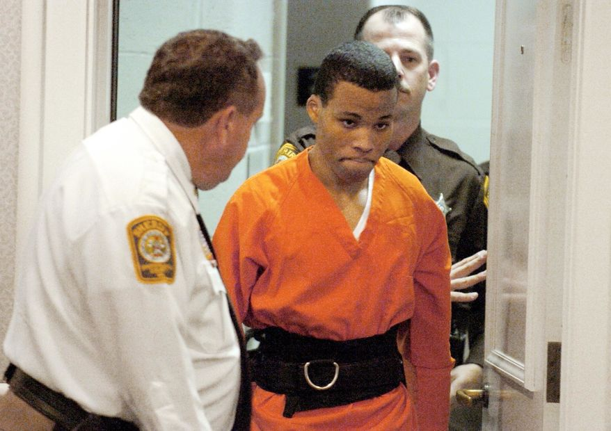 FILE - In this Oct. 26, 2004, file photo, Lee Boyd Malvo enters a courtroom in the Spotsylvania, Va., Circuit Court. A federal judge has tossed out two life sentences for D.C. sniper shooter Lee Boyd Malvo and ordered Virginia courts to hold new sentencing hearings. In a ruling issued Friday, U.S. District Judge Raymond Jackson in Norfolk said Malvo is entitled to new sentencing hearings after the U.S. Supreme Court ruled that mandatory life sentences for juveniles are unconstitutional. (Mike Morones/The Free Lance-Star via AP)