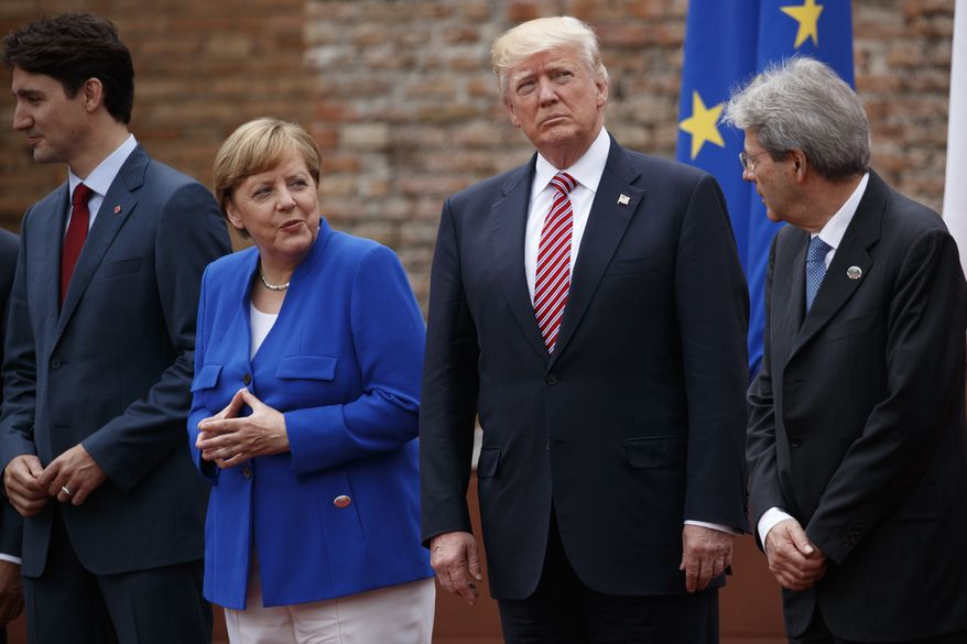 G7 leaders, from left, Canadian Prime Minister Justin Trudeau, German Chancellor Angela Merkel, President Donald Trump, and Italian Prime Minister Paolo Gentiloni, pose for a family photo at the Ancient Greek Theater of Taormina, Friday, May 26, 2017, in Taormina, Italy. (AP Photo/Evan Vucci)