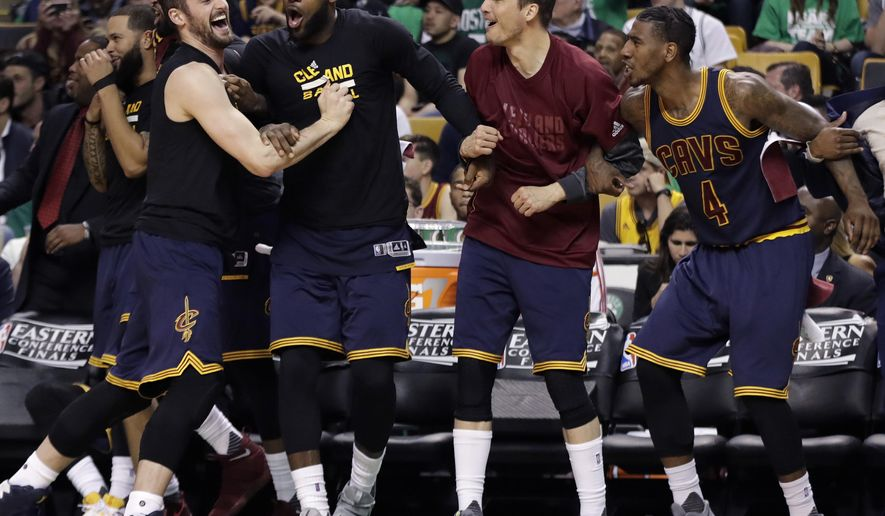Cleveland Cavaliers, from left, Kevin Love, LeBron James, Kyle Korver and Iman Shumpert celebrate a basket during the second half of Game 5 of the NBA basketball Eastern Conference finals against the Boston Celtics, on Thursday, May 25, 2017, in Boston. (AP Photo/Elise Amendola)