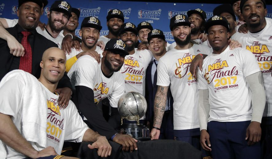 The Cleveland Cavaliers pose with their trophy after winning Game 5 of the NBA basketball Eastern Conference finals against the Boston Celtics 135-102, on Thursday, May 25, 2017, in Boston. (AP Photo/Elise Amendola)