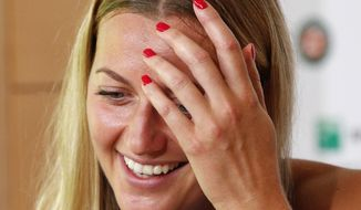 Petra Kvitova of the Czech Republic smiles during a press conference at the Roland Garros stadium, Friday, May 26, 2017 in Paris. Kvitova has confirmed she is making her comeback at the French Open, less than six months after being attacked by a knife-wielding intruder. Kvitova has missed all season so far while recovering from surgery on her left, racket-holding hand in December. (AP Photo/Christophe Ena)