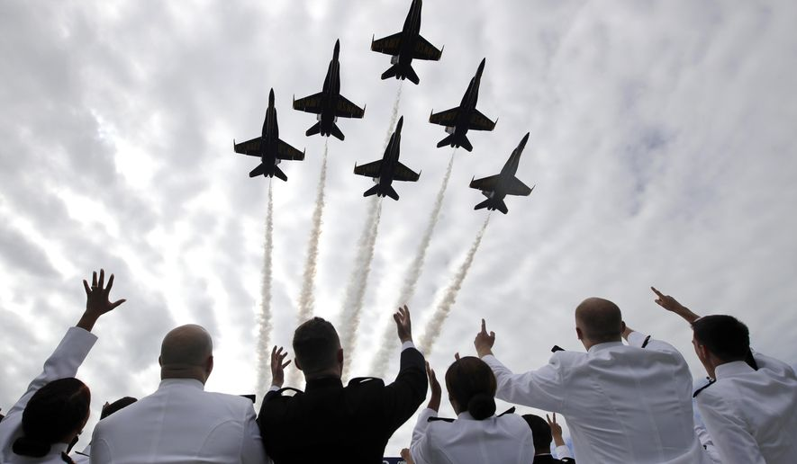 U.S. Navy Blue Angels perform a flyover above graduating U.S. Naval Academy midshipmen during the Academy's graduation and commissioning ceremony in Annapolis, Md., Friday, May 26, 2017. (AP Photo/Patrick Semansky) ** FILE **