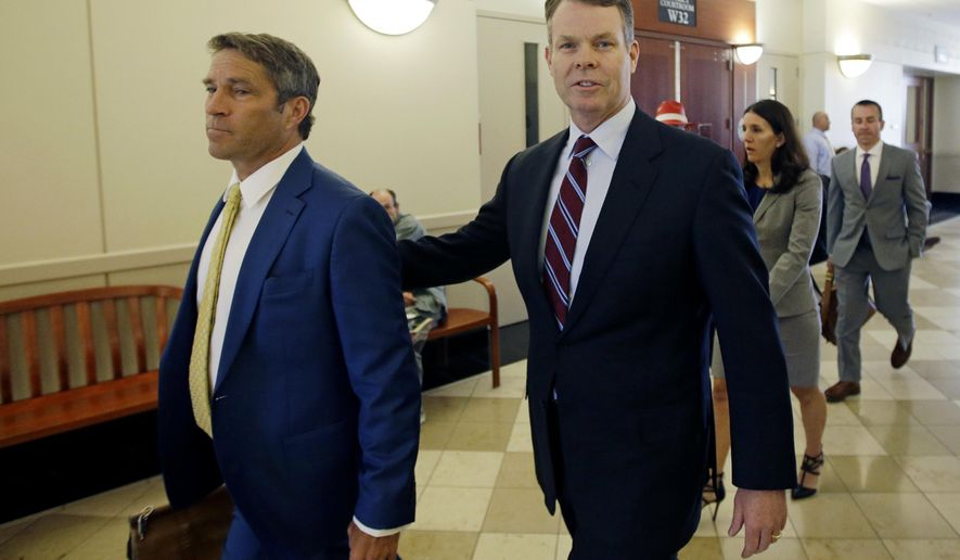 FILE - This April 12, 2016, file photo, former Utah attorney general John Swallow, right, arrives to court with his defense attorney Scott C. Williams, in Salt Lake City. The state of Utah is refusing to pay $1.5 million in legal bills for the former Utah Attorney General acquitted of bribery and other charges. The Utah Attorney General's Office said in a letter released Friday, May, 26, 2017, that the office doesn't have the money to pay the bills for John Swallow. (AP Photo/Rick Bowmer, File)