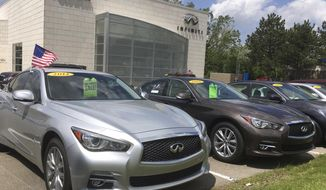 In this Wednesday, May 17, 2017, photo, used Infiniti Q50 luxury sedans await buyers at a dealership in the Detroit suburb of Novi, Mich. Leases are ending on a large number of Q50s and other cars, flooding the market with quality used cars. (AP Photo/Tom Krisher)