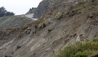 A car turns around on Highway One at the north section of the Mud Creek slide as it covers Highway One in southern Monterey County on the coast of Big Sur, in Calif., Thursday, May 25, 2017. One of the wettest winters in decades in California has triggered slides and road closures along the central coast's Big Sur, forcing some resorts to close and others to use helicopters to carry in guests and supplies.  (Vern Fisher/The Monterey County Herald via AP)