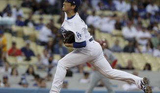 Los Angeles Dodgers starting pitcher Kenta Maeda, of Japan, throws against the St. Louis Cardinals during the first inning of a baseball game in Los Angeles, Thursday, May 25, 2017. (AP Photo/Chris Carlson)
