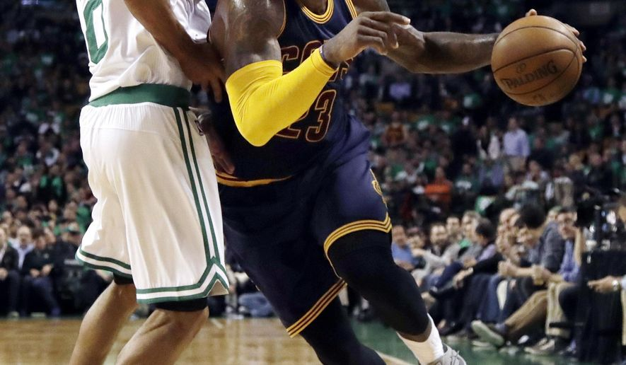 Cleveland Cavaliers forward LeBron James, right, drives against Boston Celtics guard Avery Bradley during the second half of Game 5 of the NBA basketball Eastern Conference finals, on Thursday, May 25, 2017, in Boston. (AP Photo/Elise Amendola)