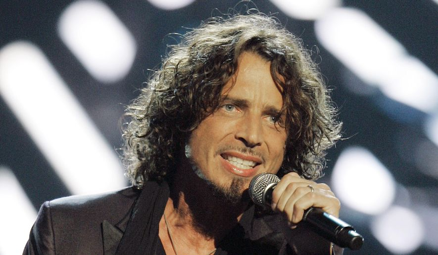 In this Sept. 5, 2008, file photo, musician Chris Cornell performs on stage during Conde Nast's Fashion Rocks show in New York. Soundgarden frontman Cornell is being laid to rest Friday, May 26, 2017, at Hollywood Forever Cemetery in Los Angeles. Representatives for the late singer-songwriter say private memorial service Friday will be followed by a public viewing of Cornell's burial site. (AP Photo/Jeff Christensen, File)
