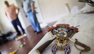 A piece of Confederate memorabilia to General Robert E. Lee sits atop a box at the Nash Farm Battlefield Museum, a small Civil War museum closing in Hampton, Ga., Thursday, May 25, 2017. Against the backdrop of the removal of Confederate symbols from public spaces around the South, the closure of the small Civil War museum in Georgia has stirred up strong emotions. (AP Photo/David Goldman)