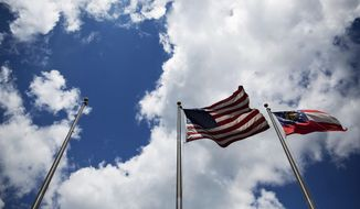 An American and Georgia state flag fly next to where a Confederate flag once flew outside the Nash Farm Battlefield Museum in Hampton, Ga., Thursday, May 25, 2017. Against the backdrop of the removal of Confederate symbols from public spaces around the South, the closure of the small Civil War museum in Georgia has stirred up strong emotions. (AP Photo/David Goldman)