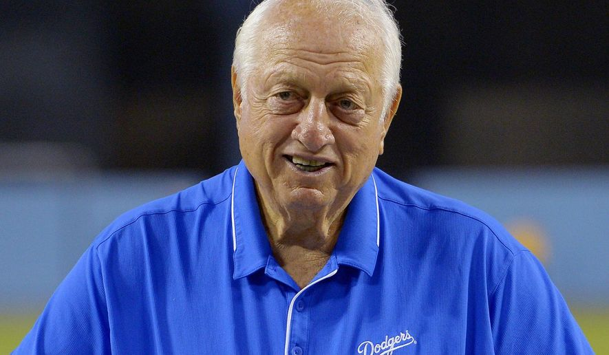 "FILE - In this Sept. 22, 2015, file photo, former Los Angeles Dodgers manager Tommy Lasorda poses prior to a baseball game against the Arizona Diamondbacks, in Los Angeles. Hall of Fame manager Tom Lasorda is recovering after surgery to replace his pacemaker. The Dodgers said Friday, May 26, 2017, on Twitter that Lasorda ""is doing well."" He had the surgery Thursday. (AP Photo/Mark J. Terrill, File)"