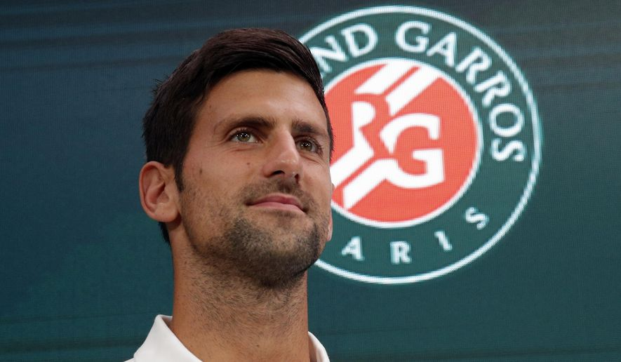 Defending champions Serbia's Novak Djokovic listens before the draw of the French Open tennis tournament at the Roland Garros stadium, Friday, May 26, 2017 in Paris. The French Open tennis tournament starts Sunday. (AP Photo/Christophe Ena)