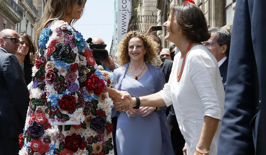US First Lady Melania Trump, left, is welcomed by Emanuela Mauro, spouse of Italian Premier Paolo Gentiloni at Chierici Palace, part of a visit of the G7 first ladies in Catania, Italy, Friday, May 26, 2017. On Friday and Saturday, for the first time all seven are around the same table, including also newcomers Emmanuel Macron of France, Theresa May of Britain and the Italian host, Paolo Gentiloni, forging a new dynamic after a year of global political turmoil amid a rise in nationalism. (AP Photo/Domenico Stinellis)