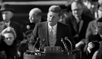 """FILE - In this file photo dated Jan. 20, 1961, U.S. President John F. Kennedy delivers his inaugural address at Capitol Hill in Washington, after taking the oath of office. That rallying cry from his inaugural address - """"Ask not what your country can do for you; ask what you can do for your country"""" - is etched both in stone and in the minds of generations of Americans. Kennedy didn't make it even halfway to 100 - a milestone he might have celebrated May 29, 2017 - but the slain U.S. president's legacy is being lived out by his descendants. (AP Photo, File)"""